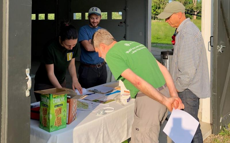Sara Amish and Trevor Nelson--two SVT AmeriCorps members--gave volunteers their property assignments on the morning of the BioBlitz.