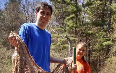 SVT Stewardship Assistant James Farrell and SVT Land Steward Morgan Chambers preparing jute netting for a restoration area along Cranberry Brook at SVT's Memorial Forest.